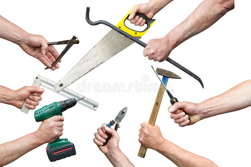 Hands of workers with tool kit royalty free stock photo