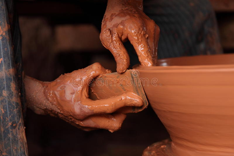 Hands working on crockery stock images
