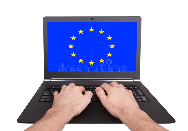 Hands working on laptop, European Union. Hands working on laptop showing on the screen the flag of European Union royalty free stock image