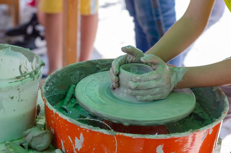 Hands working on pottery. royalty free stock photography