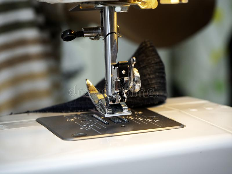 Hands working on the sewing machine stock photography