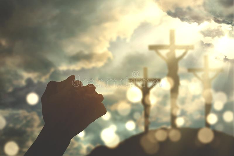Hands worship with three cross signs. Silhouette of two christian person hands worshipping to the GOD with three crucifixion signs royalty free stock photos