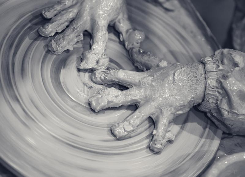 Hands of young girl in clay on pottery wheel royalty free stock photos