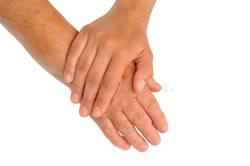 Hands of young and senior women stock photo
