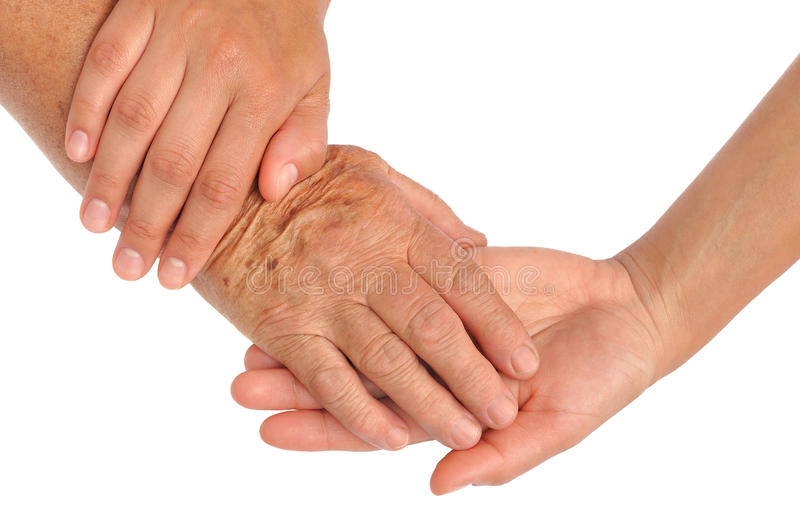 Hands of young and senior women royalty free stock image