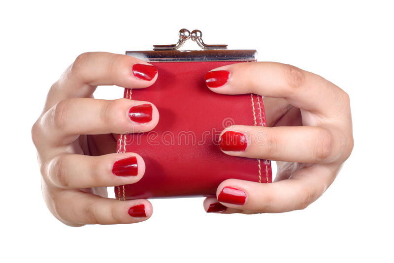 The hands of a young woman with a coin purse. On white background stock image