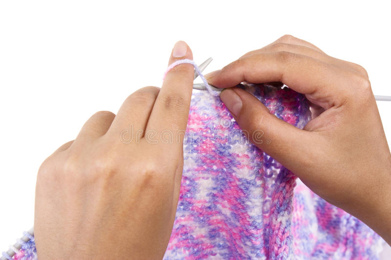 Hands of a young woman knitting royalty free stock images