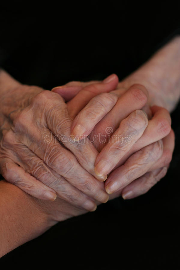 Hands, Youth and Elderly stock images