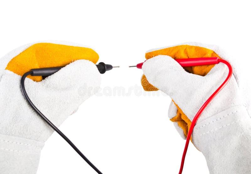 Handschoenen die met sondesmultimeter handelen stock afbeeldingen