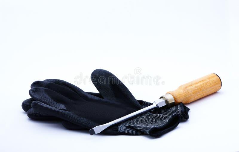 Handschoenen en Schroevedraaier royalty-vrije stock foto's