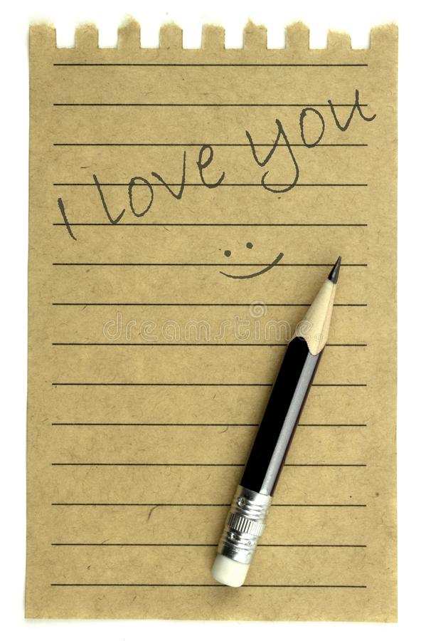 Handschrift I houdt van u op een natuurlijk notadocument stock fotografie
