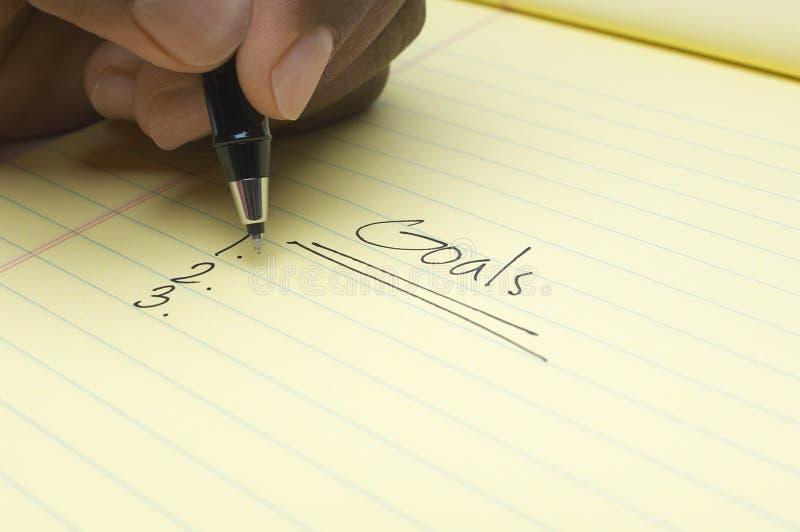 Handschrift-Liste von Zielen auf Notizblock stockfotos