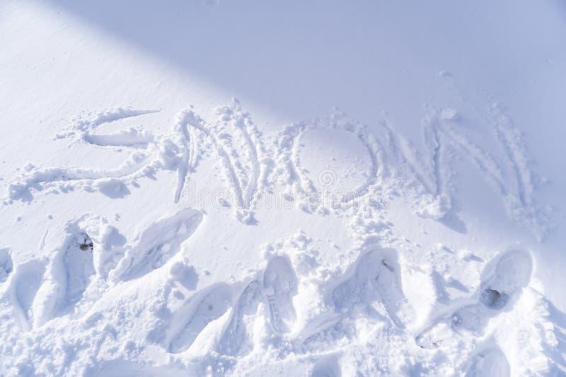 Handschrift van Sneeuwtekst royalty-vrije stock afbeeldingen