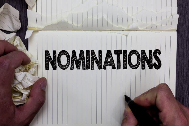 Handschriftstext-Schreiben Nominierungen Konzeptbedeutung Vorschläge von jemand oder von etwas für eine Jobposition oder -preis N lizenzfreie stockfotografie
