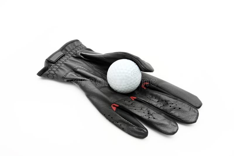 Handschuh und Golfball stockfotografie