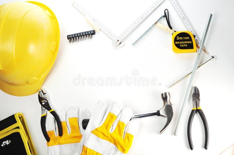Handschuhe und Hammer stockbilder