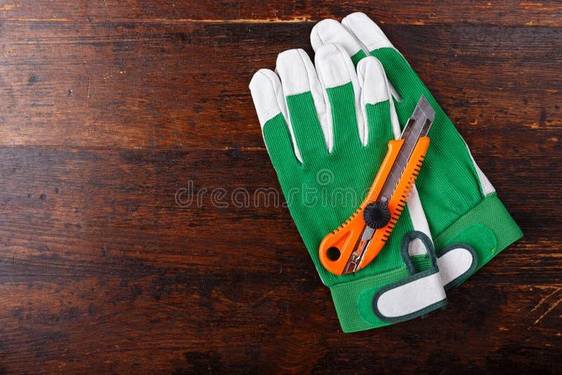Handschuhe und Schneider lizenzfreie stockbilder