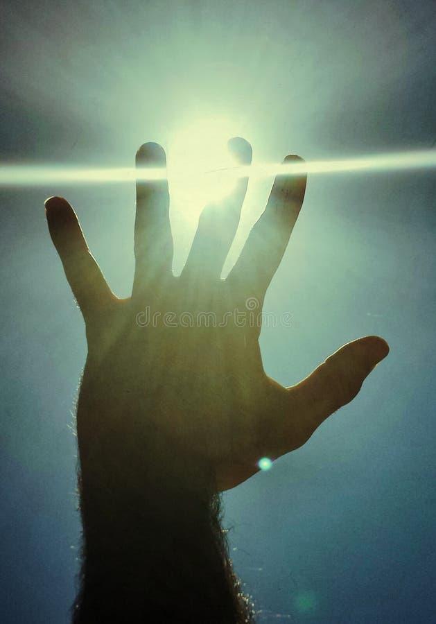 Handschutz durch Sonne stockfotos