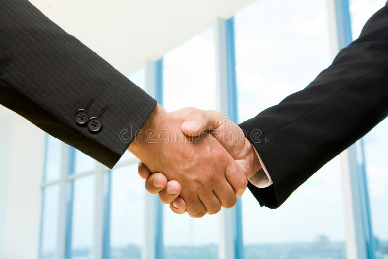 Handshake. Photo of handshake of business partners after striking deal stock photography