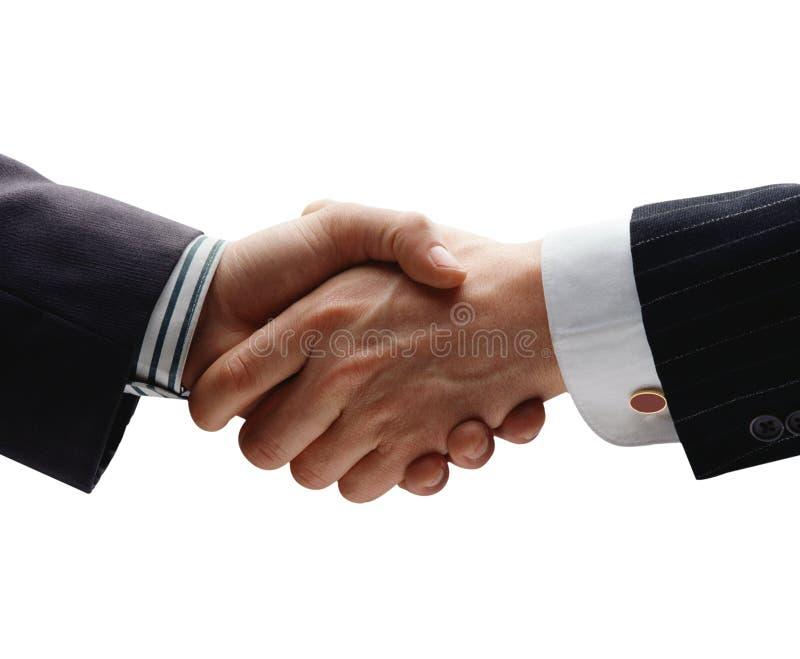 Handshake. Business handshake over blue background stock photography