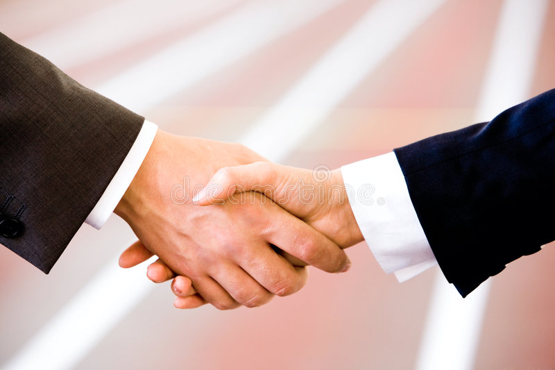 Handshake. Of business people on the background of running-track royalty free stock photos