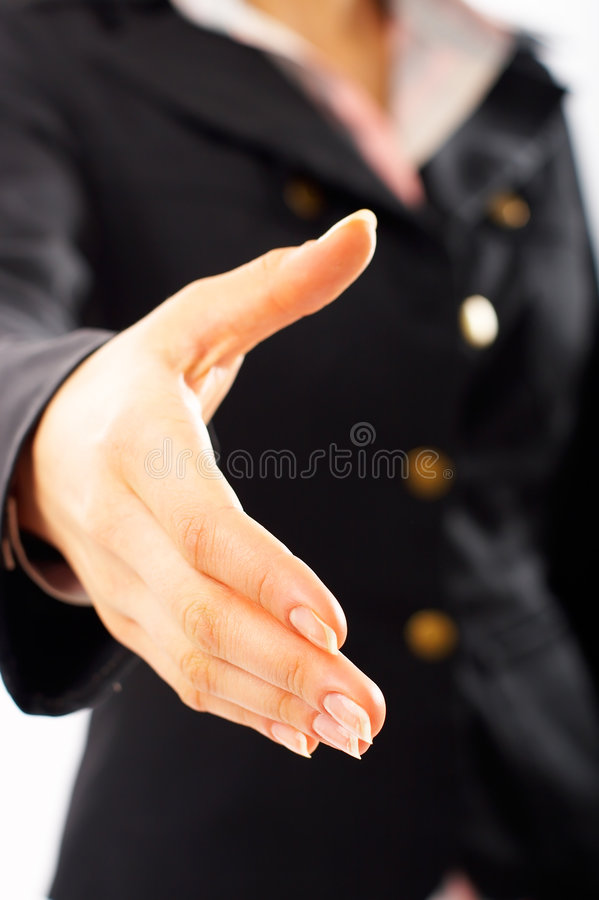 Handshake. Close-up of woman ready for handshake. Shallow depth of field, focus on finger-tips