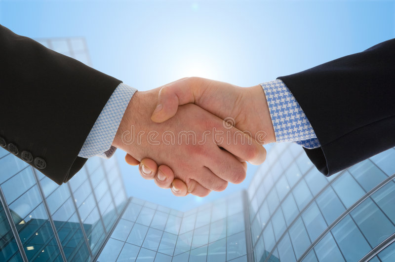 Handshake. With modern skyscrapers as background