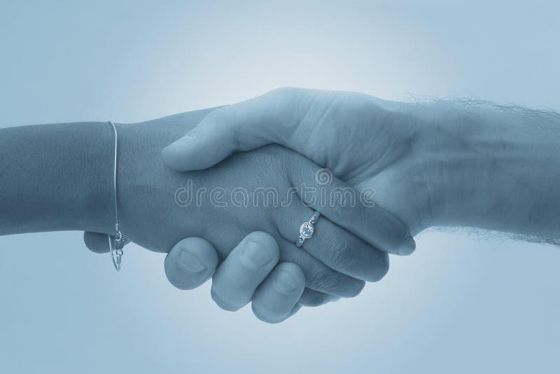 Handshake. Handshaking hands stock photo