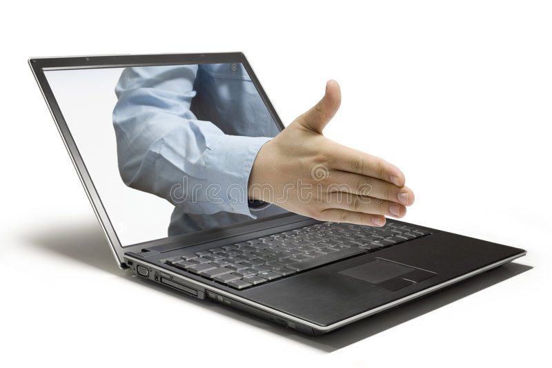 Handshake. Hands reaching out of a laptop