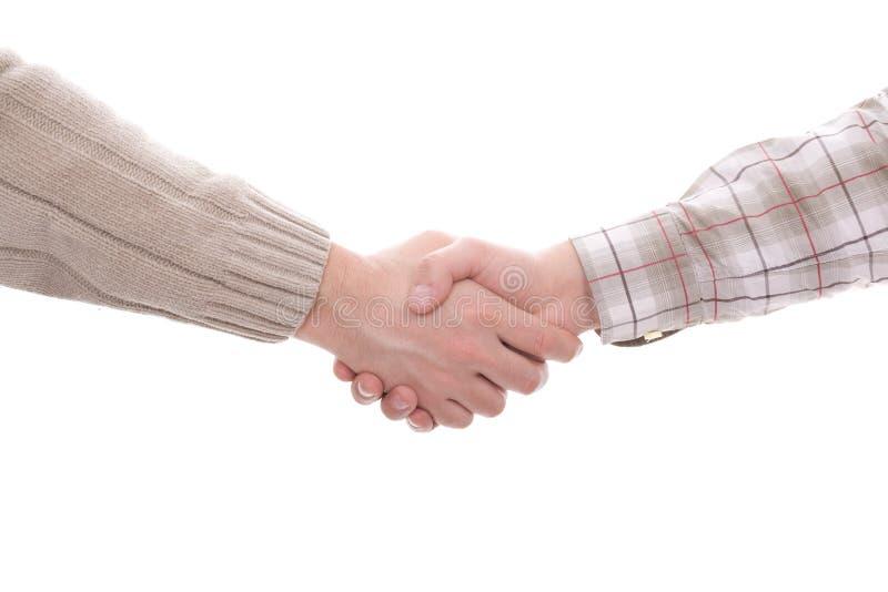 Handshake. Detail of an handshake, isolated in white background stock photos
