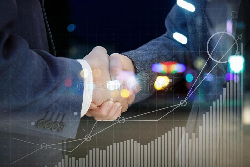 Handshake against the backdrop of the financial growth . stock image