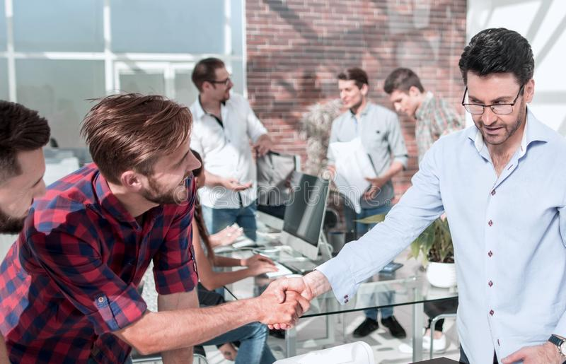 Handshake of the architect and contractor over a work Des stock photo