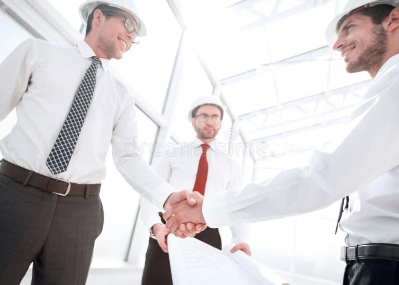 Handshake between architect and customer stock image