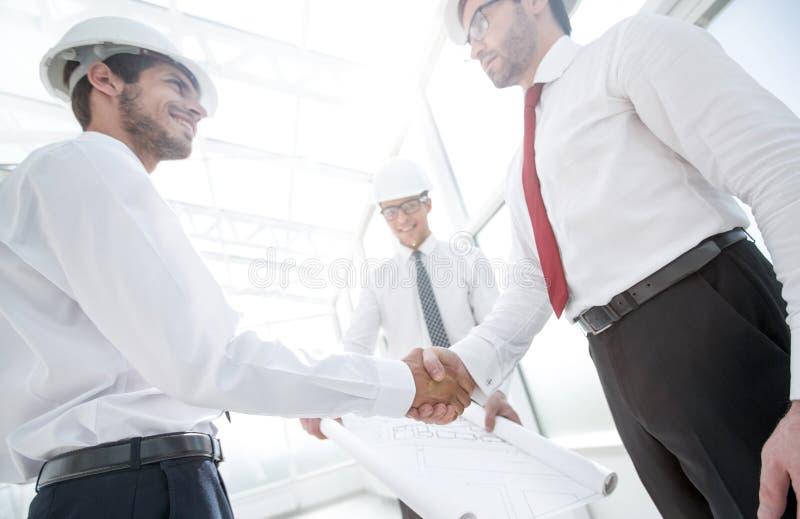 Handshake between architect and customer royalty free stock photography