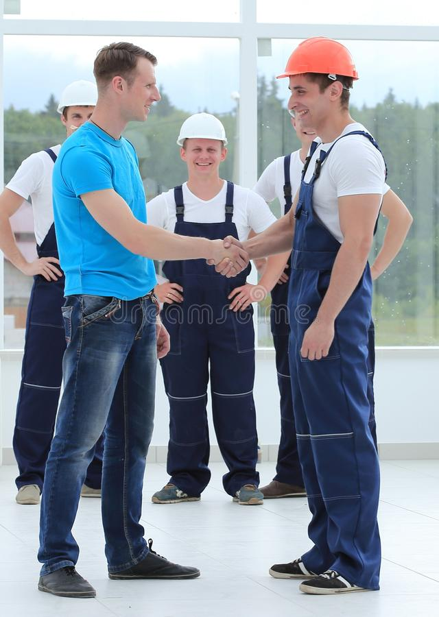 Handshake of the architect and engineer royalty free stock photography