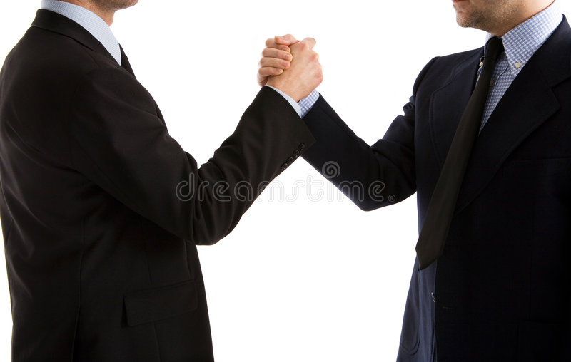 Handshake or Arm Wrestle. Two businessmen shaking hands in a friendly way, or arm wrestling to emphasize an agreement or disagreement royalty free stock photography