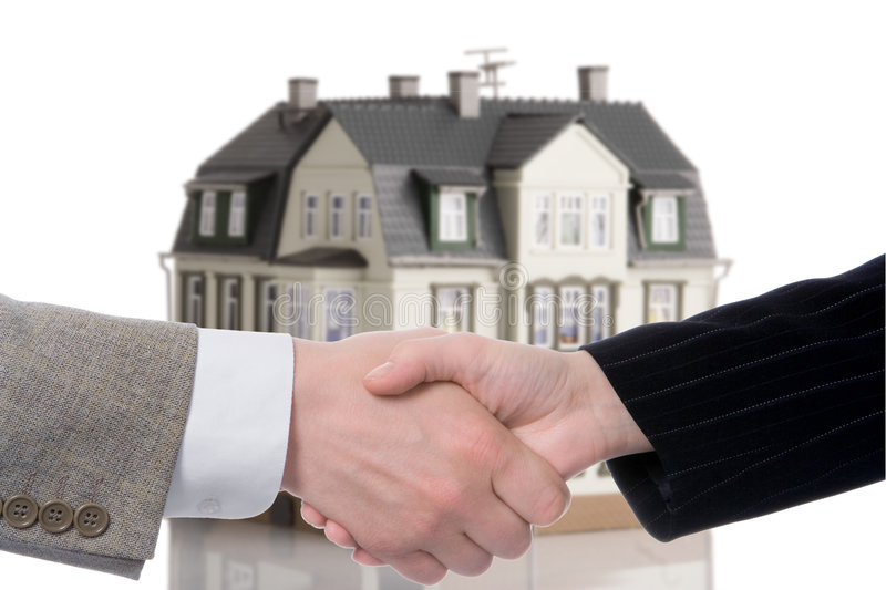 Handshake arrangement buying - selling of house royalty free stock image