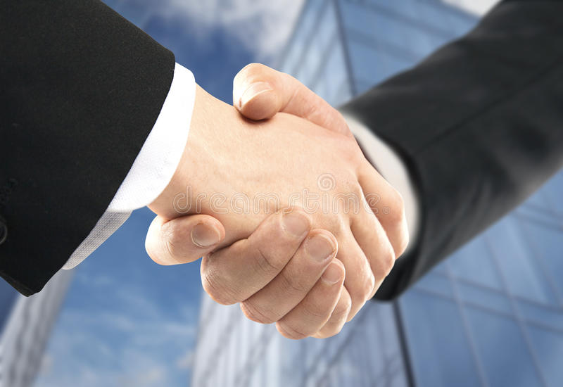 Handshake. On background of modern building royalty free stock photography