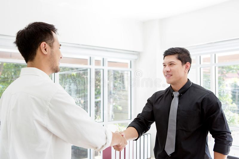 Handshake. Business associate shaking hands in office. Two businessmen shaking hands in office. Business success.Handshake. Business associate shaking hands in stock images