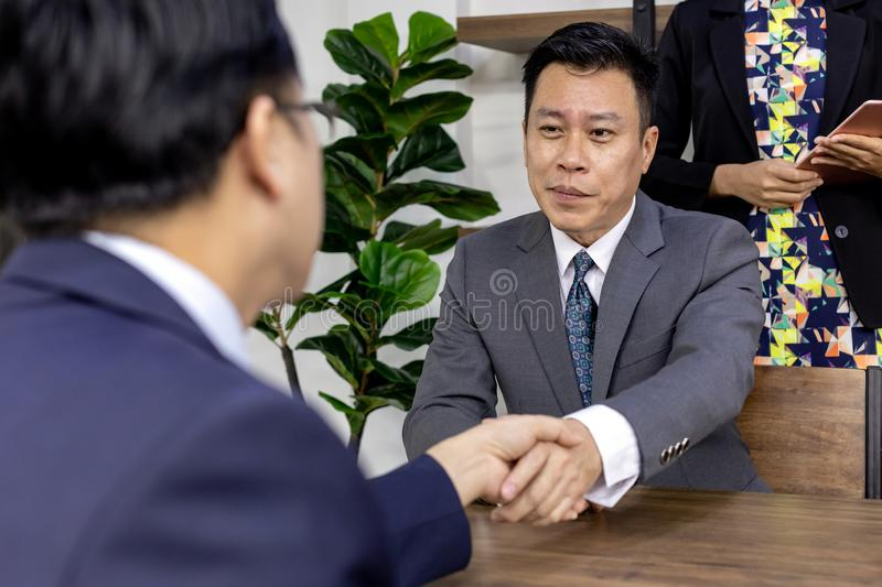 Business deal in a cafe stock images