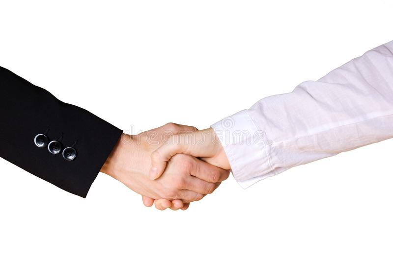 Handshake between business hands. One white and one black dressed arm, on white royalty free stock photography