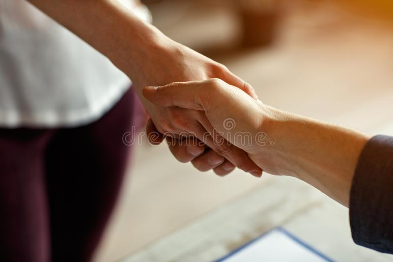 Handshake on business meeting. Female and male shake hands on meeting indoor stock photos