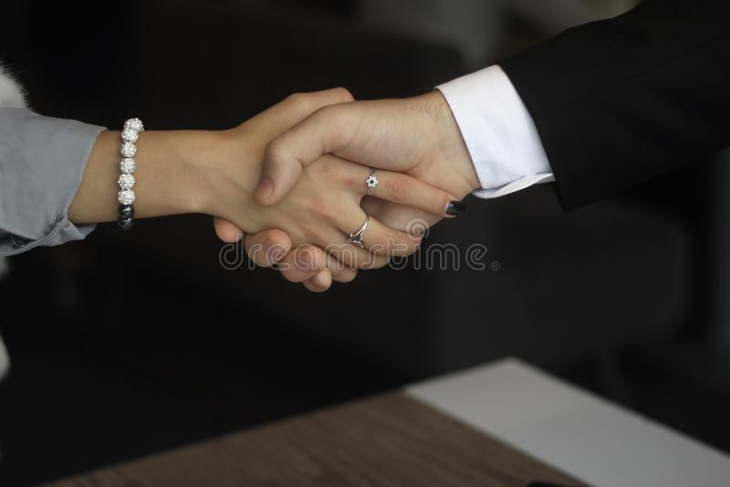 Handshake between business partners on the background of the office. royalty free stock photos