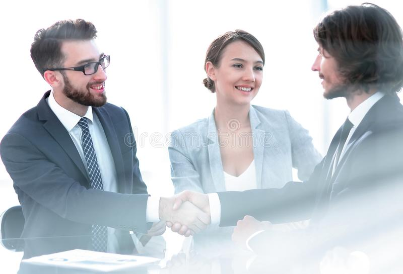 Handshake of business partners.business background. Background image of handshake of business partners.business background.business concept royalty free stock photography