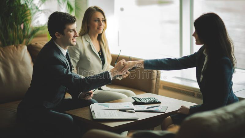 Handshake of business partners after discussing a new financial contract stock image