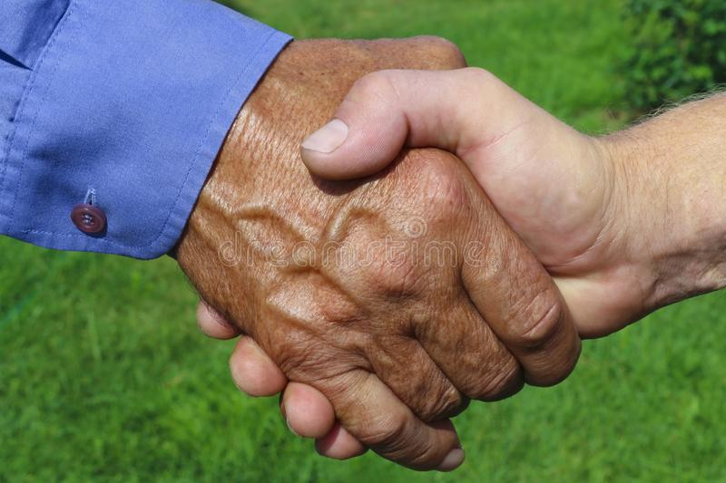 Handshake of business partners, farmers on green background stock photos