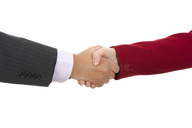 Handshake of business partners, men and women in the office stock image