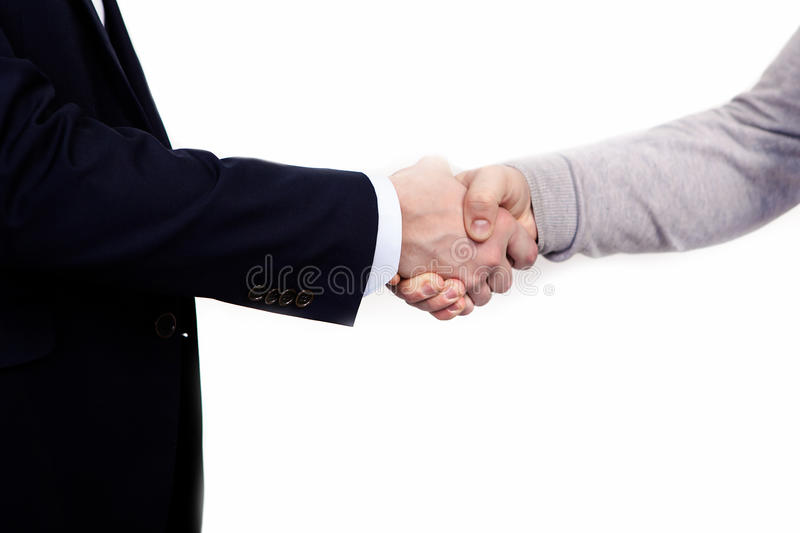 Handshake of business partners, when signing documents. Isolated on white background stock image