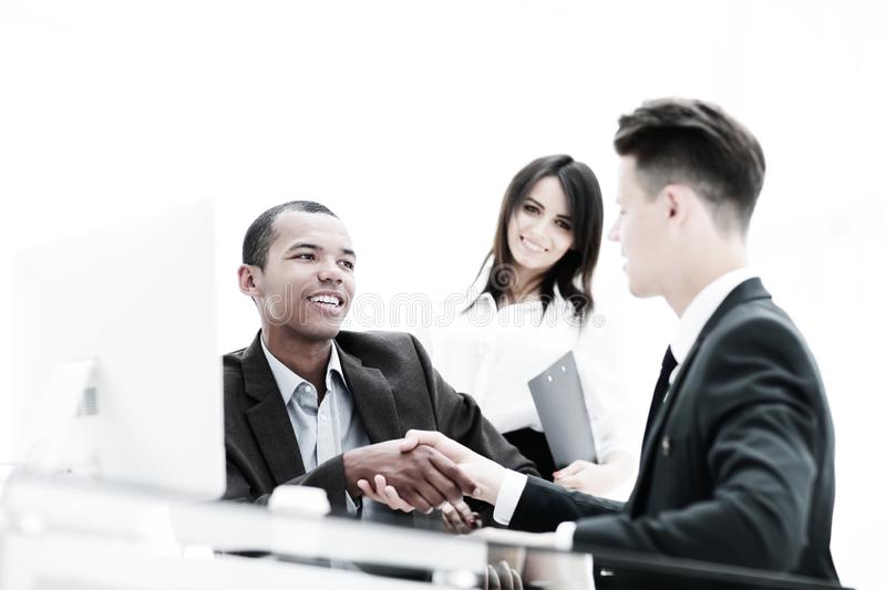 Handshake of business partners sitting at a table Desk stock photo