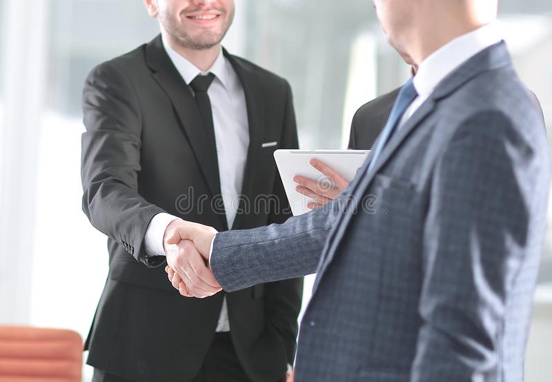 Handshake business partners standing next to the Bank office royalty free stock photography